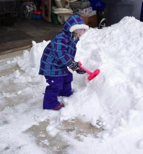 Rylin shoveling