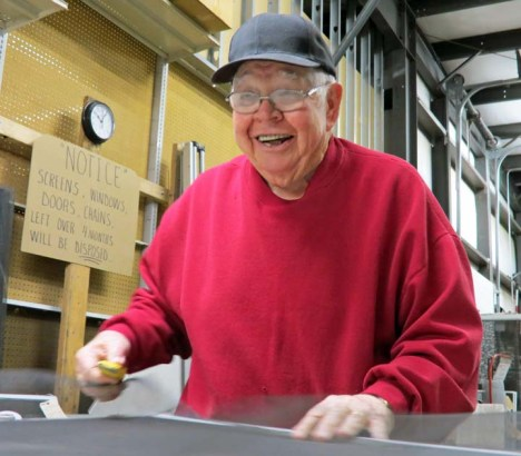 Bill Harralson, one of the many pioneers of the Olathe Youth Baseball program, now 76, spends much of his time repairing windows at the ACE Hardware store in Gardner. Photo by Chuck Kurtz