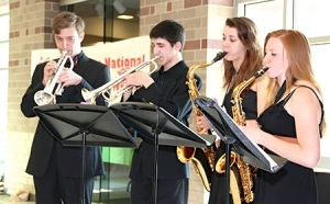 The Olathe East High School Jazz Combo provided the entertainment at this year's bash. Members of the Olathe Northwest High School Raven Link Crew served as greeters at the front door and helped guests find their table.