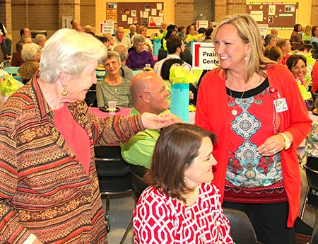 Pam Wolfe, of the Community Development Office, presented a service pin to Seniors Serving Schools volunteer Sandra Hanson. More than 35 pins were presented during this year's volunteer appreciation bash. Pins are awarded annually for five, 10, 15 and 20 years of service. Photos by Marlene Colgan
