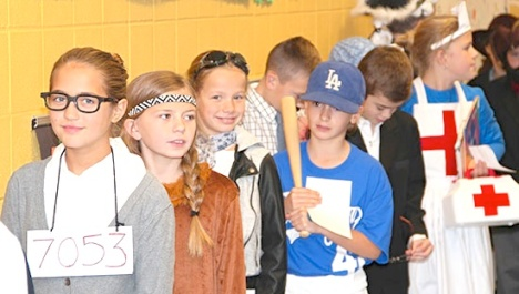 "Civil rights activist Rosa Parks, Native American Pocahontas, aviatrix Amelia Earhart, Major League Baseball's Jackie Robinson and American Red Cross founder Clara Barton waited in line with other historical figures before the wax museum began. ""The kids really had a good time,"" fifth-grade teacher Carrie Hoffman said."