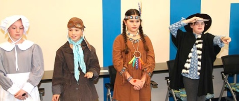 Pioneer author Laura Ingalls Wilder, aviation pioneer Amelia Earhart, Native American Pocahontas and British explorer Captain James Cook stood very still as they waited for visitors to come press their activation button (a mark on their hand). Photos by Marlene Colgan
